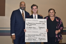 Connor MacFarlane (center) with contest judges and novelty checks for 250 and 1,000 dollars