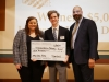 Connor MacFarlane (center) with contest judges a novelty checks for 5,000 dollars